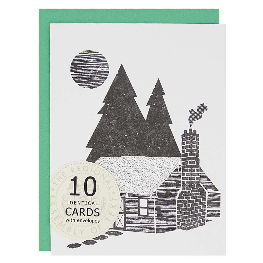 "This cozy cabin is the perfect card to spread some winter wishes. Depicts a black and white cabin in the woods with some smoke coming from the chimney.Boxed set contains 10 identical cards (blank inside) & 10 jade envelopes. Cards measure 4¼"" x 5½""."