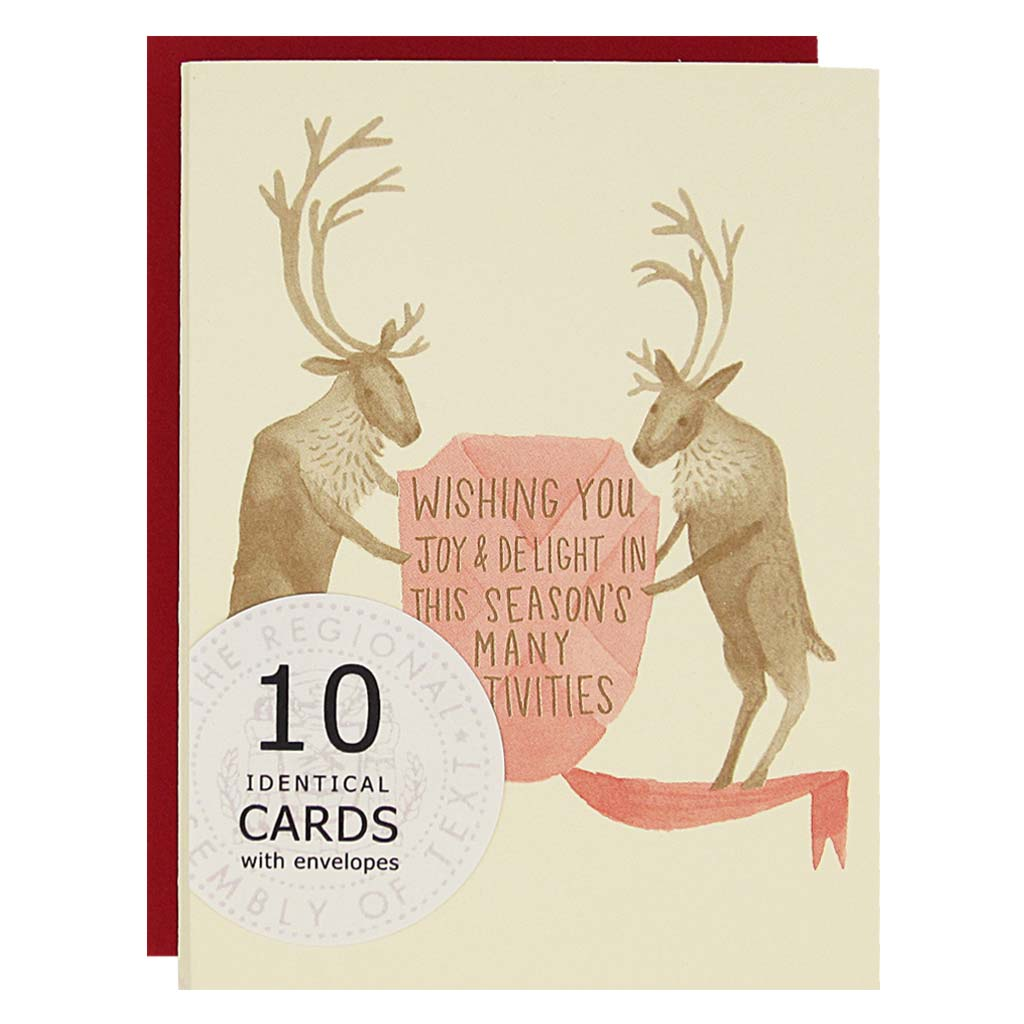 "Let these caribou help send some joy. Text reads ""wishing you joy and delight in this season's many festivities. Boxed set contains 10 identical cards (blank inside) & 10 red envelopes. Cards measure 3½""x 5""."