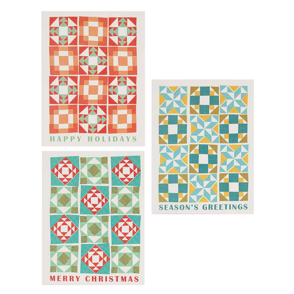 "Boxed set contains 12 assorted cards (blank inside) depicting quilt patterns and holiday wishes. Comes with 12 white envelopes. Includes 4 of each design. Cards measure 4¼"" x 5½""."