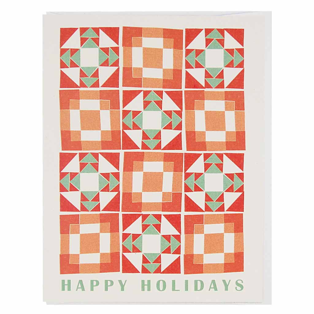 "A cheery little holiday card that looks like a vintage quilt pattern with the words ""happy holidays"" at the bottom.Measures 4¼"" x 5½"", comes with a white envelope & is blank inside."