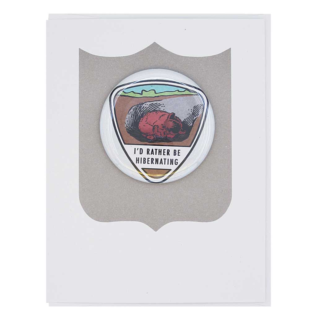 "Let's just sleep forever. Features a 2¼"" button of a bear curled up sleeping that reads ""I'd rather be hibernating"" that can be taken off and worn by the recipient. Card measures 4¼"" x 5½"", comes with a white envelope & is blank inside."