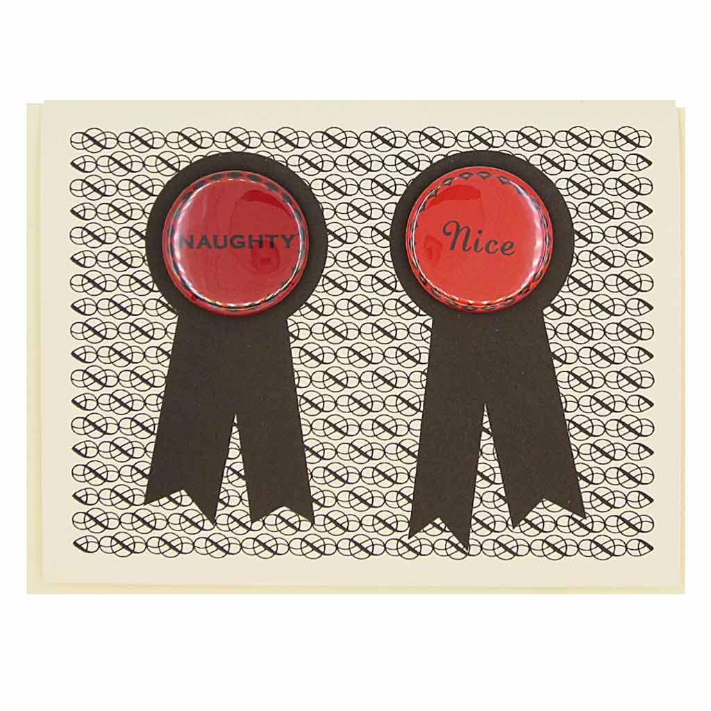 "Opposites attract. Features two 1¼"" buttons, one that says ""Naughty"" and the other says ""Nice"", that can be taken off and proudly worn by the recipients. Card measures 4¼"" x 5½"", comes with a cream envelope & is blank inside."