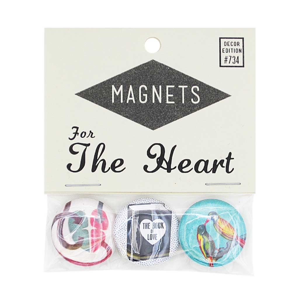 "Show your love with this pack of three 1"" magnets. Images on magnets include: A book of love, a sciency image of a heart with arrows, two brightly coloured birds. Pack measures 3"" x 3½""."