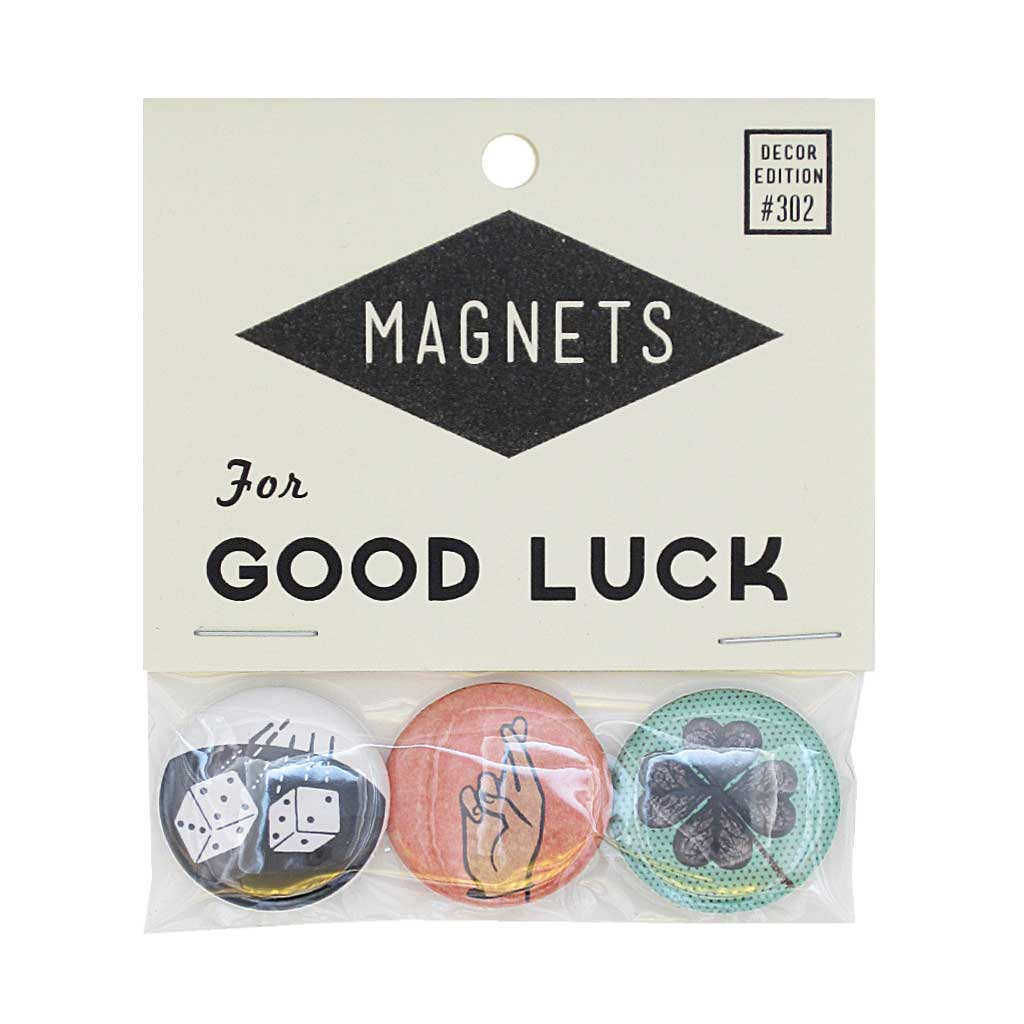 "Spread some good luck with this pack of three 1"" magnets. Dice, fingers crossed and 4 leaf clover. Pack measures 3"" x 3½""."