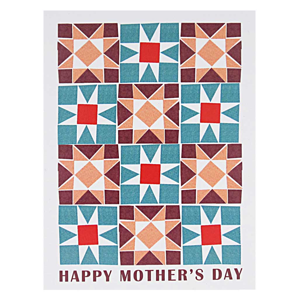 "This Mother's Day card has a colourful geometric quilt pattern with text below that reads 'Happy Mother's Day'. Card measures 4¼"" x 5½"", comes with a white envelope & is blank inside. Designed by The Regional Assembly of Text."