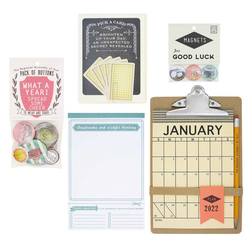 What a Year indeed! This kit is intended to help spread cheer and look forward. Items included: a daydream notepad, magnets, a handy clipboard 2021 calendar, and a fortune card to brighten the day. Detail of stationery.