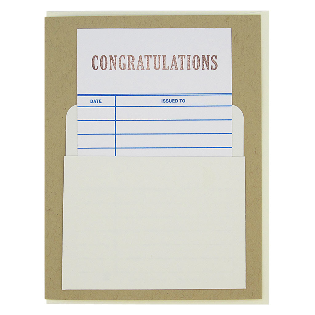 "This nostalgic card is kraft  coloured and has a real library card that slides in & out of a real library pocket on the front. The top of the library card is stamped 'Congratulations'. Fill in the date and name of the recipient to personalize. Card measures 4¼"" x 5½"", comes with a cream envelope & is blank inside. Designed by The Regional Assembly of Text."