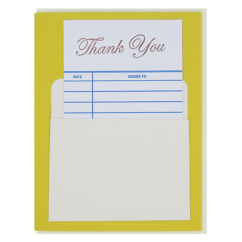"This nostalgic card is a yellow and has a real library card that slides in & out of a real library pocket on the front. The top of the library card is stamped 'Thank You'. Fill in the date and name of the recipient to personalize. Card measures 4¼"" x 5½"", comes with a cream envelope & is blank inside. Designed by The Regional Assembly of Text."