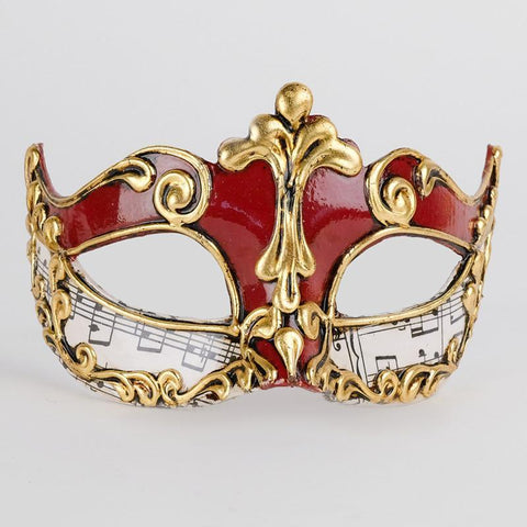red and gold mask with musical notes