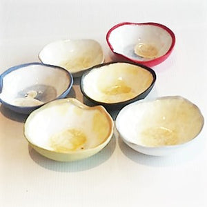 small porcelain bowl with crystalline glaze inside and coloured outside.