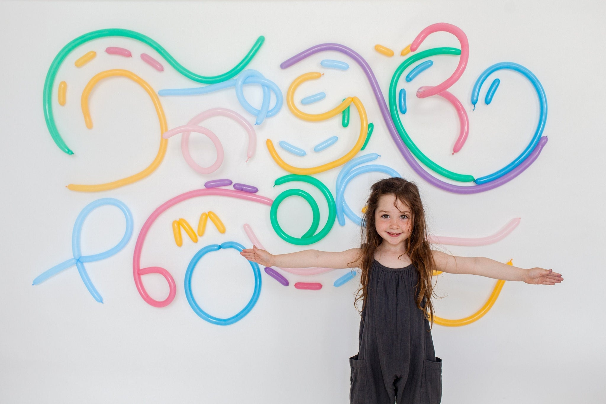 Cool Balloon Backdrop Wall made with Modelling Balloons