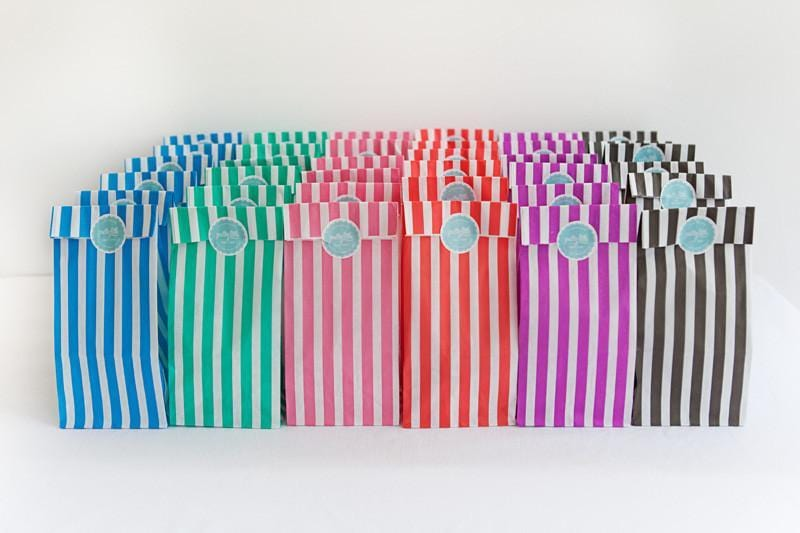 Row of stripey paper party bags
