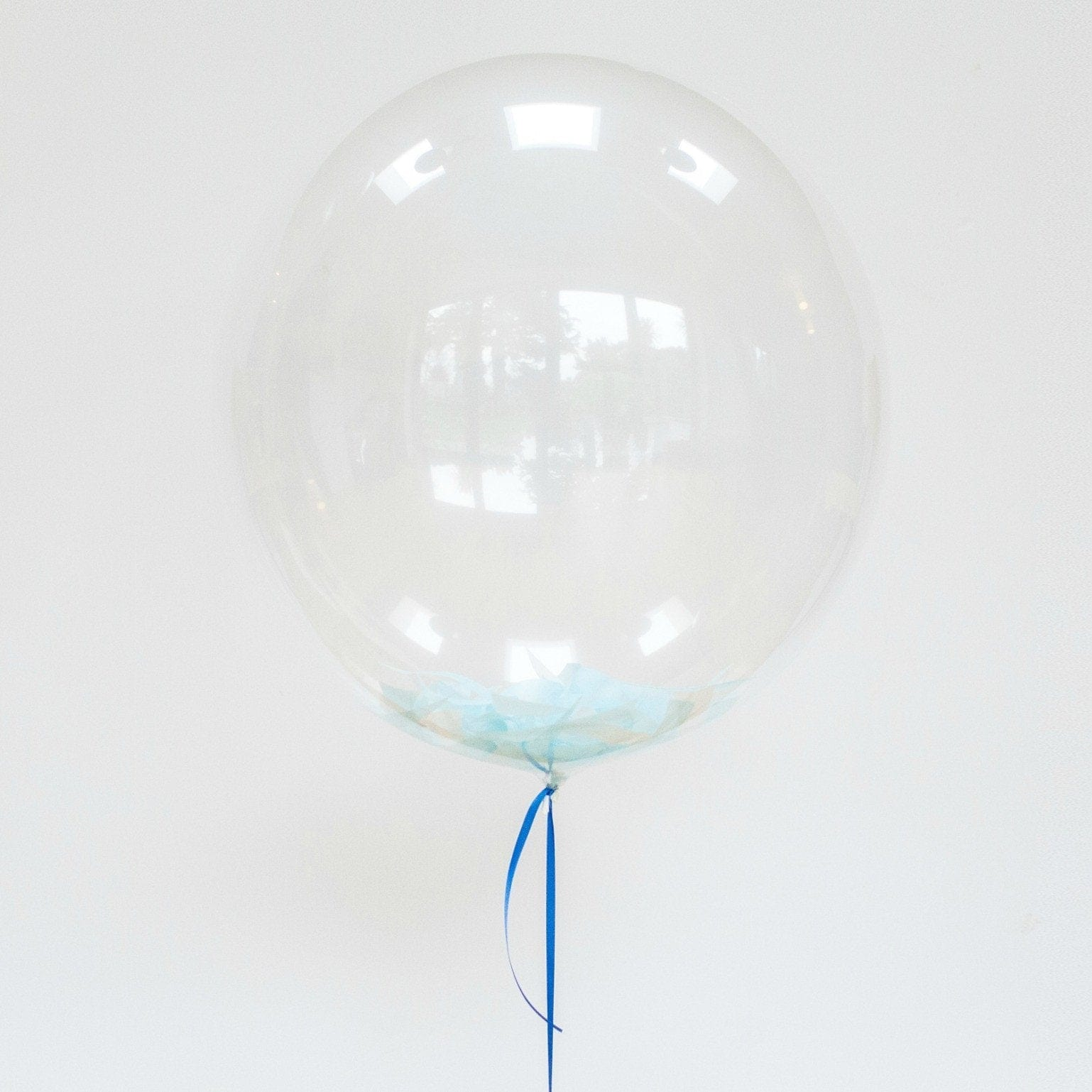 Feather filled bubble balloons | Bubble balloon ideas UK