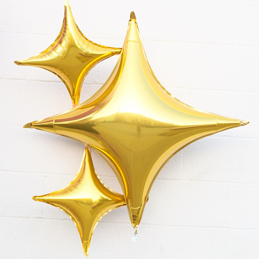 Gold four point star foil
