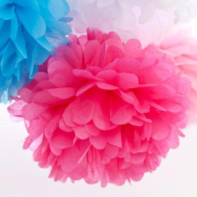A hot pink tissue paper pom pom