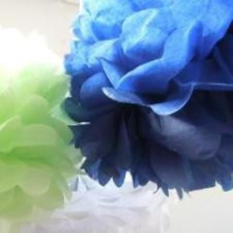 A tissue paper pom pom in navy blue