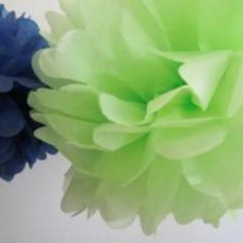 A tissue paper pom pom in kiwi green