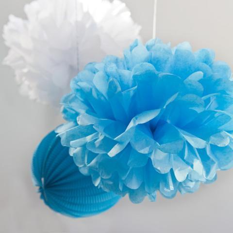 Pretty tissue paper pom pom in aqua blue