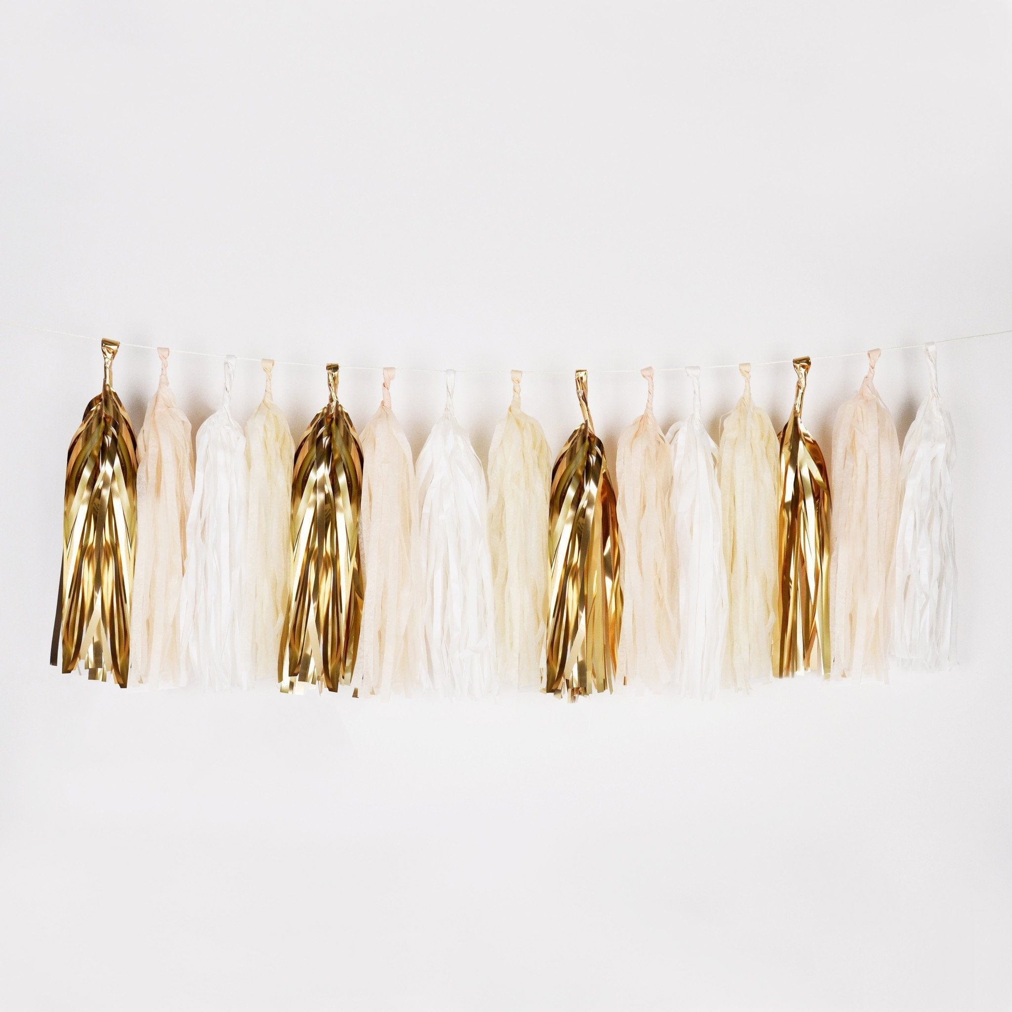 white, cream and gold tassel garland
