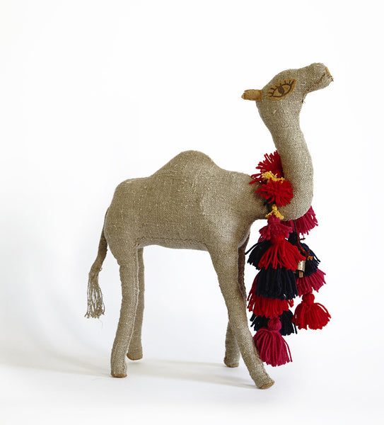 Camel with colorful pompom