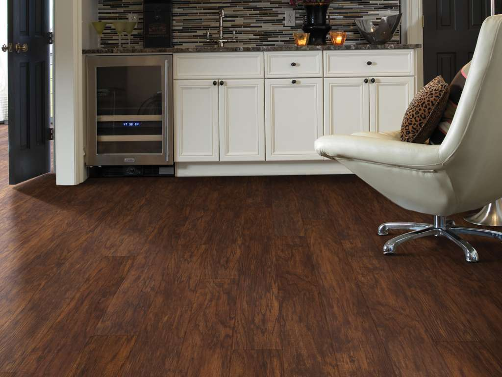 Dark Wood Vinyl Plank Flooring with White Cabinetry