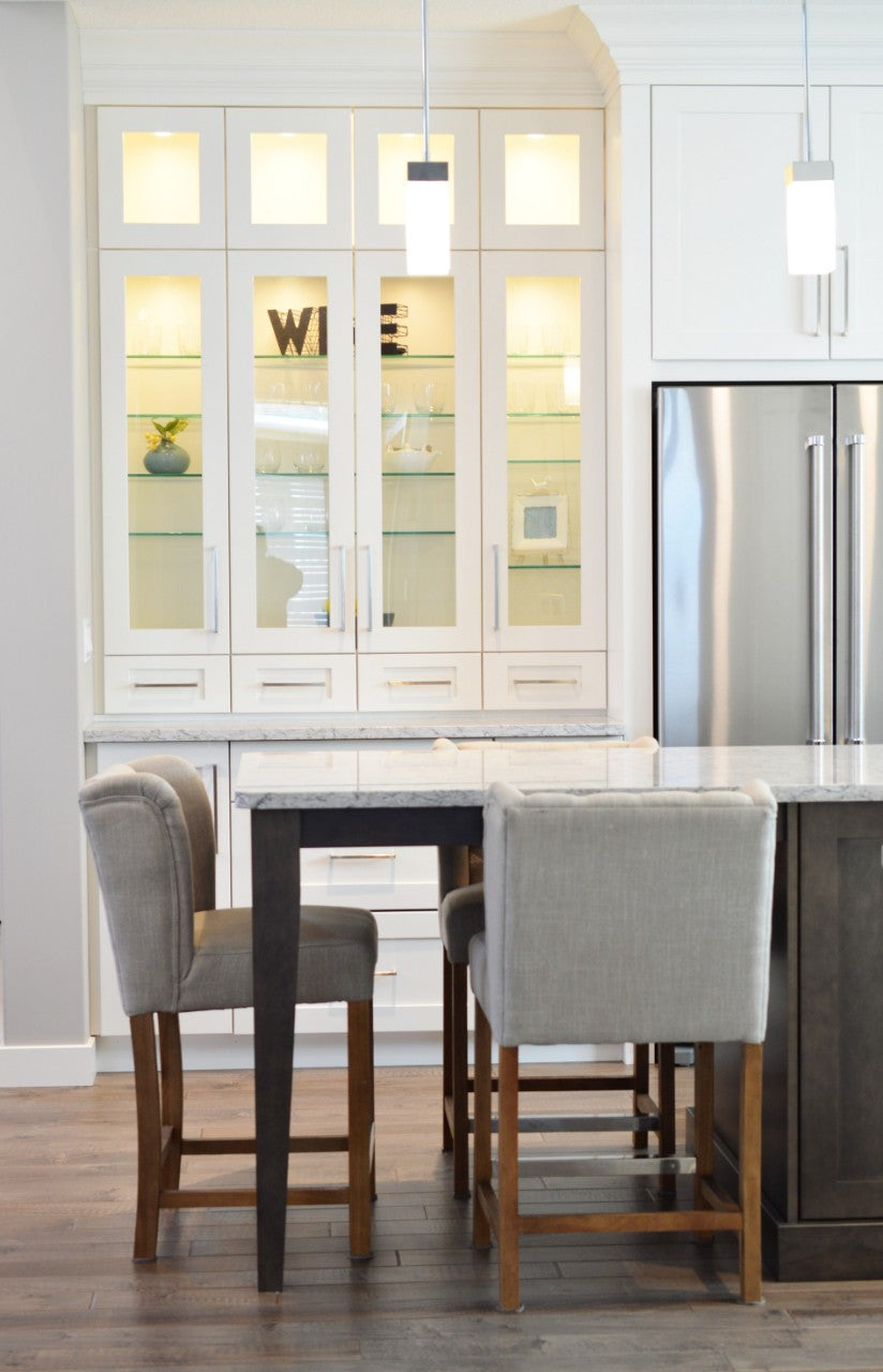 Kitchen Dining Area with Gray Chairs and White Hutch