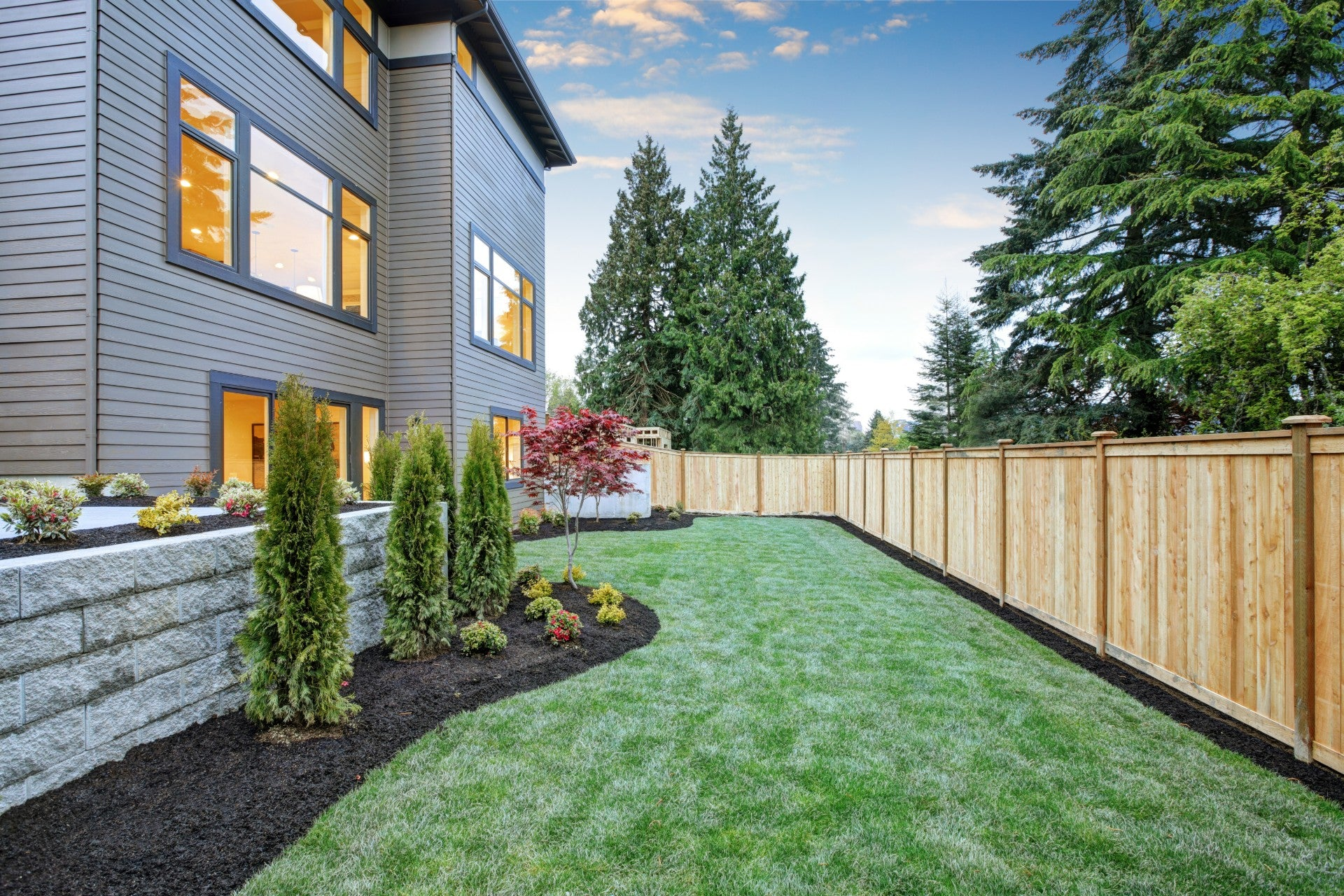 Landscaped Backyard with Wooden Fence