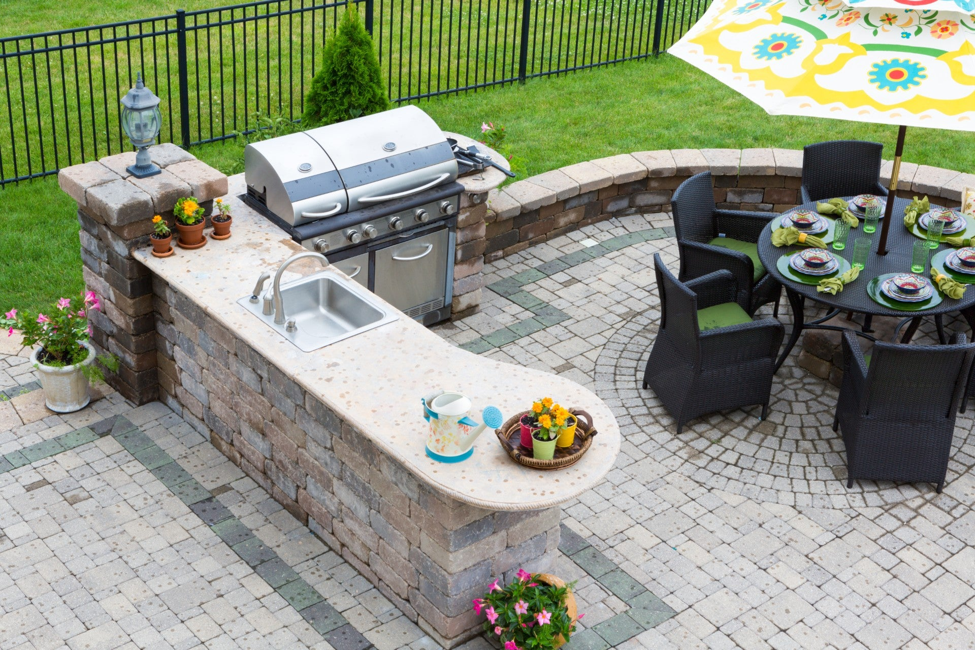 Patio and Outdoor Kitchen with Built In Grill and Seating Area