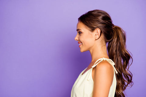 woman with pretty ponytail on purple background