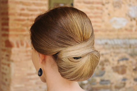 a woman with a beautiful chignon hair style