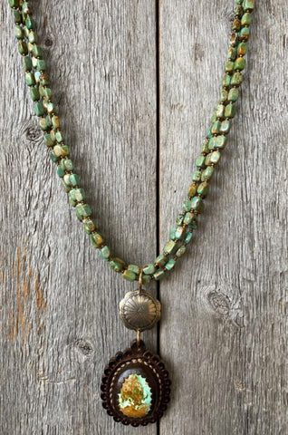 J.Forks Designs Necklace with Turquoise. This necklace was hanging on a wooden backdrop, and the photo was taken in Boerne, Texas.