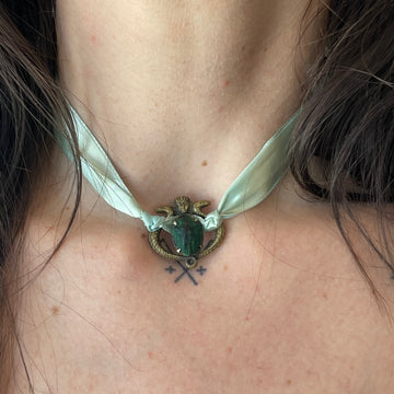 Scarab and Pharoh pendant on satin ribbon