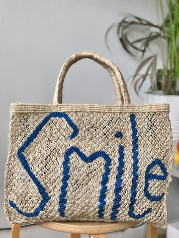 Smile Natural with Cobalt writing