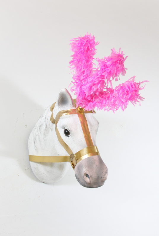 Circus horse with pink feather mount