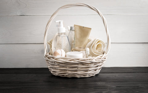 Wicker basket filled with guest toiletries for a welcoming guest bedroom