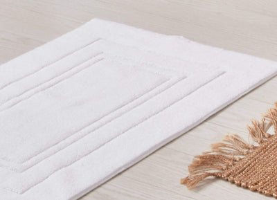 envello white cotton Bath Mat on light pine wooden floor
