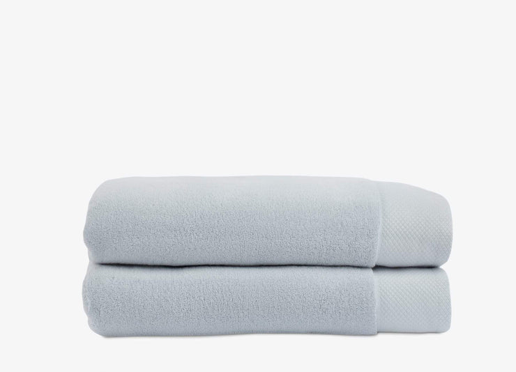 Set of light blue stacked cotton envello Bath Towels