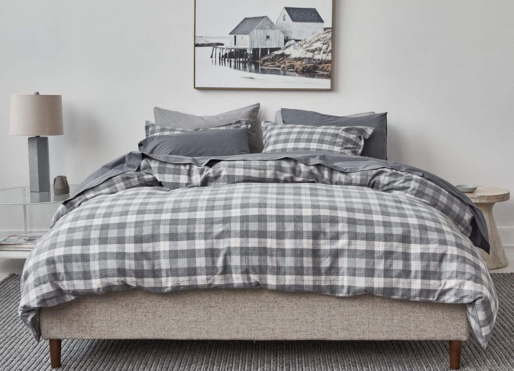 Modern bedroom and bed made up with envello Cozy Flannel duvet set with subtle light blue accent stripe.