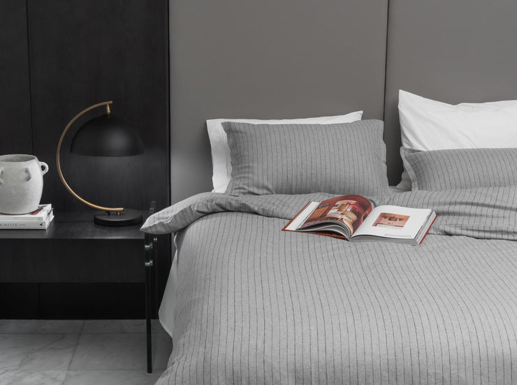Modern bedroom and bed made up with envello Cozy Flannel duvet set with subtle black pinstripe accent