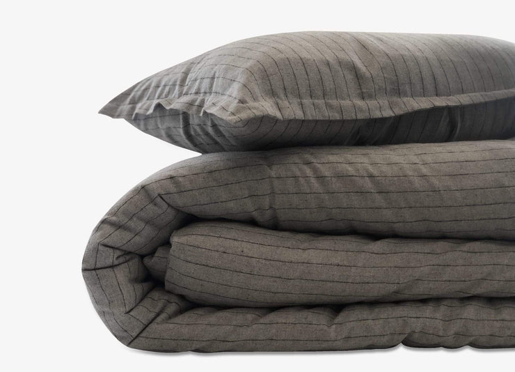 Close up of envello dark grey  with subtle contrasting black stripe Cozy Flannel duvet set.