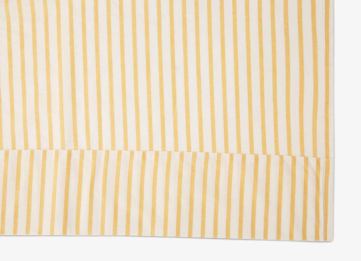 Close-up of envello Crisp Chambray yellow striped sheet set