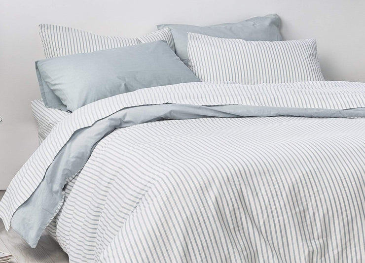 envello Crisp Chambray blue striped sheet set on bed