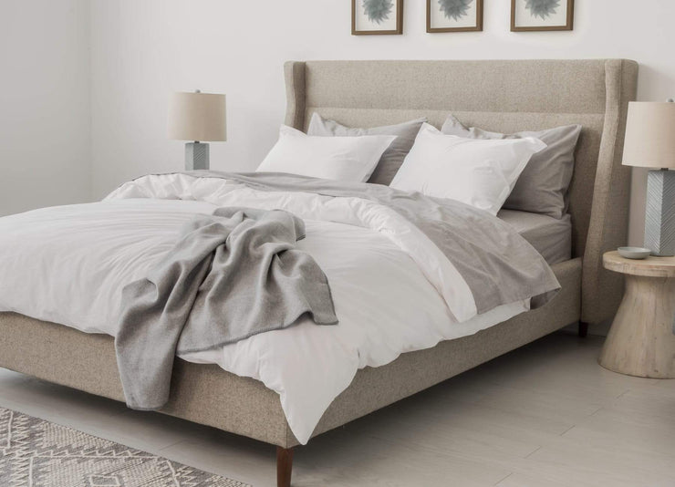 envello white cotton Premium Percale duvet set and blanket throw on modern bed with two sidetables and bedside lamps