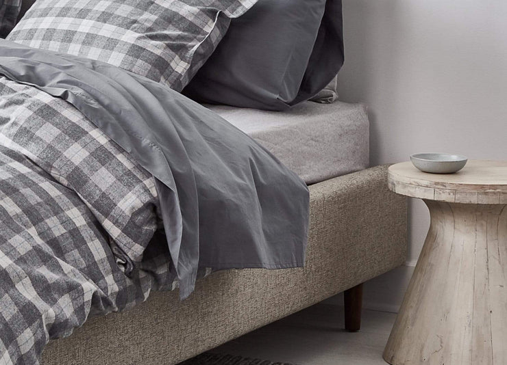 envello dark grey cotton Premium Percale sheet on bed with grey plaid Cozy Flannel Duvet Set