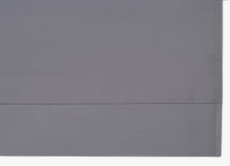 Close-up of envello dark grey cotton Premium Percale fitted sheet