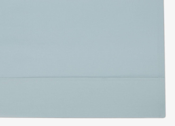Close-up of envello blue cotton Premium Percale flat sheet
