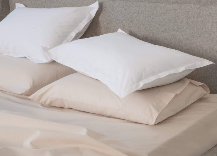 envello bone coloured cotton Premium Percale pillowcases with contrasting white duvet shams on bed