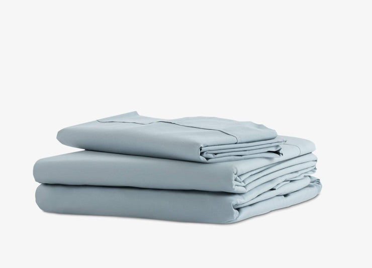 envello blue cotton Premium Percale sheet set showing 1 flat and 1 fitted sheet plus 2 pillowcases