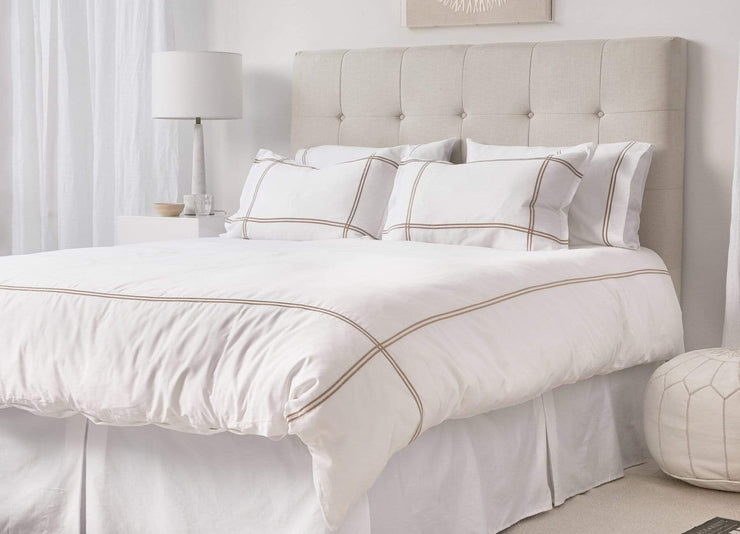 envello Select Sateen white cotton duvet set with beige accent trim on bed with creme headboard