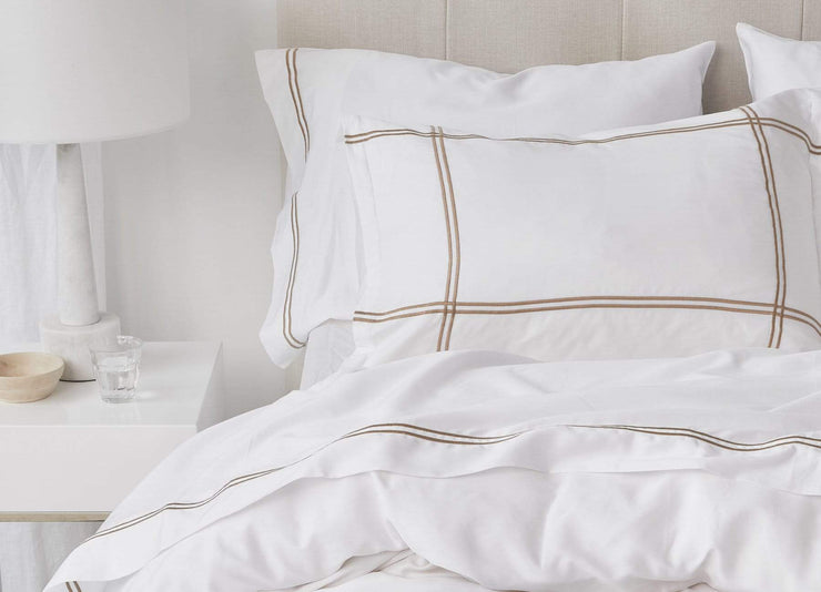 envello Select Sateen white cotton sheet set with contrasting trim featuring  1 flat and 1 fitted sheet plus 2 pillowcases on a modern bed